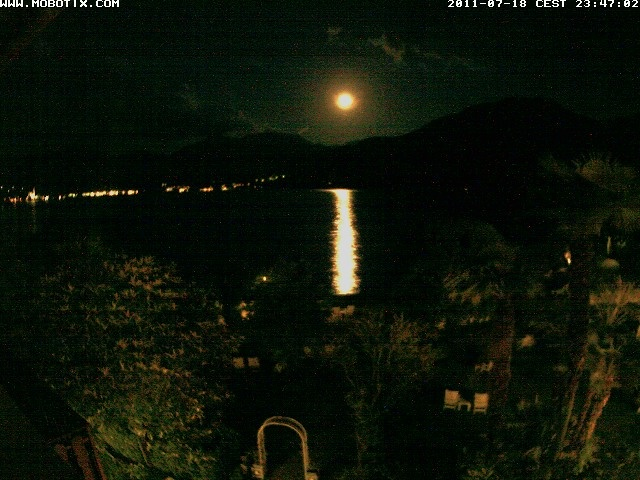 Full moon reflecting on the Como lake in front of my house. The lights of Bellagio on the other side of the lake on the left.