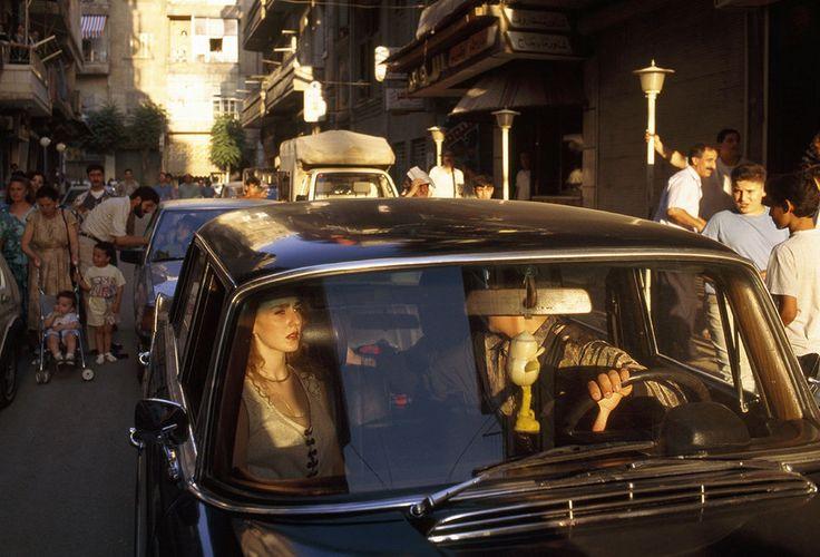 A couple stuck in a traffic jam on a bustling street in Aleppo on July 7 1996 [970660] http://ift.tt/2eaH8el