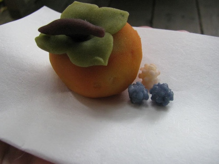 Wagashi (moist sweet) resembling a persimmon and konpeito (small hard candy), Wisteria Pavilion, Hakone Daichakai, Saratoga, Calif., Oct. 2012. Photo by Holly Harvey