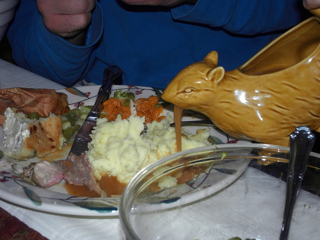 barfing squirrel gravy boat - the perfect addition to any modern kitchen.