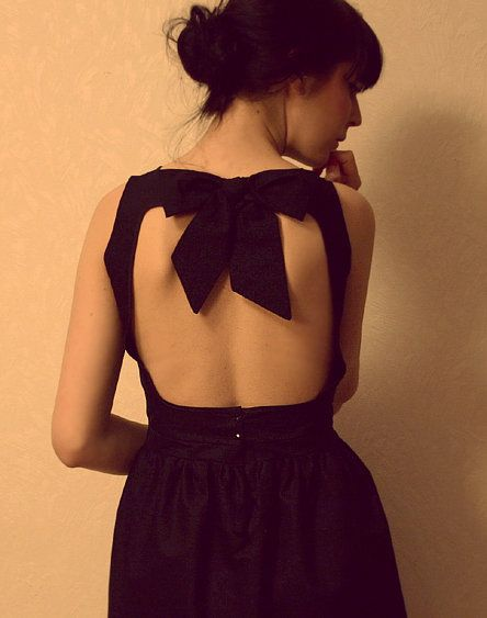 I love a good little black dress with an open back. I wish I was as crafty as this girl who sewed it herself & finished it with a bow.
