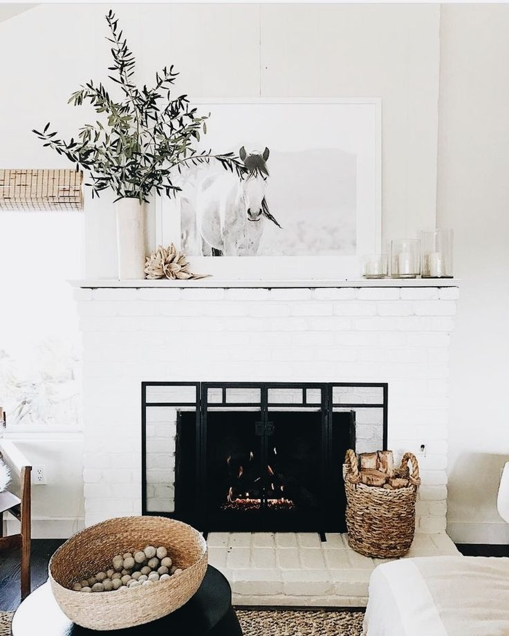 Yule style!! Noel Christmas Winter Solstice!! Modern contemporary white and black fireplace!! Simple elegant! Love the fireplace screen!