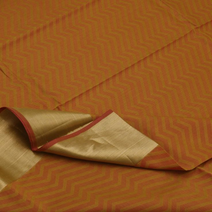 #paaduka #buysarisonline #beautifulcottons #silkcottons #Handwoven Silk Cotton Sari in Maroon & Green Zigzag Lines ~ From our summer collection, enjoy this festive silk cotton sari! The body is in zigzag bands, alternating in maroon and muted mehandi green. This geometric pattern is enriched by the rich golden bavanji border and tissue pallu. A lovely contrast is seen in the plain maroon blouse with running bavanji border. Easy to drape and elegant to look! Sari code: 700511543