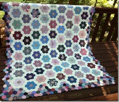 Hexagon quilt made by Bonnie Hunter