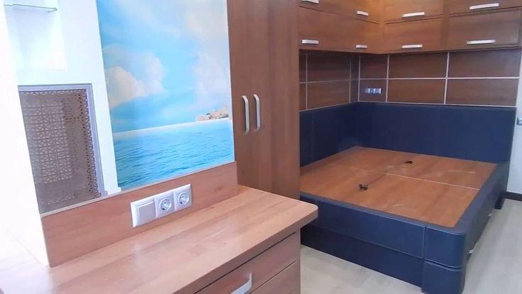 Интерьер в яхтенном стиле. Настенные шкафы и кровать - все сделано на заказ. Авторская работа.