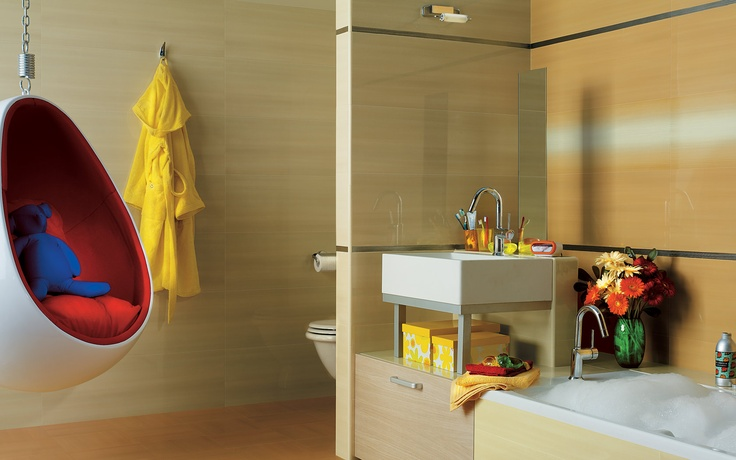 Collection: FAP Idea / Cedro   Polished, extra-glossy tiles match this bathroom's vivid accent colors.
