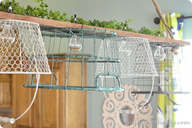 One cool chicken wire basket chandelier by All Things Thrifty, featured on I Love That Junk