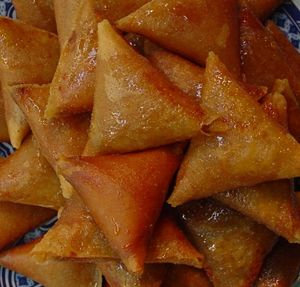 Moroccan Ramadan Sweet Briwat 1 kg phyllo dough or Moroccan warqa ( fine layered pastry)  1kg Almonds n pistas  1 half a cup of tea blossom water  150 g butter  1tsp ground cinnamon  1 half a kilo of powder sugar  1 litter oil for frying  1 kg of honey  2 tbsp of flour in half cup of water