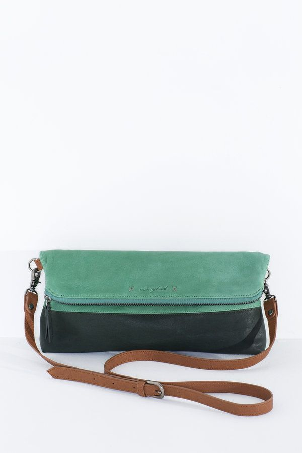 A great bag/clutch, that folds and expands depending on what you have to carry. A cute embossed motif adds character to this classic shape.  internal...