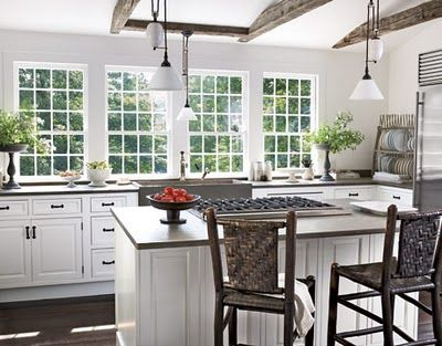 Reclaimed wood beams, white kitchen cabinets, big windows in kitchen.... i'm in love