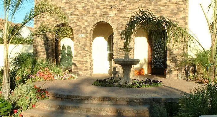 Add elegance to your front entryway with interlocking paving stone and stone veneer by Genesis Stoneworks
