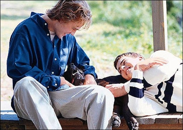 """Dawson and Pacey play with a dog while discussing their life dreams. 
