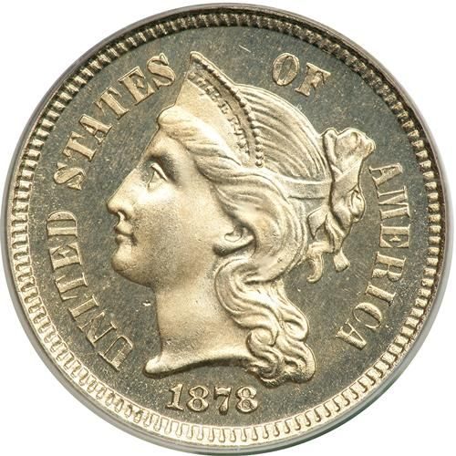 1878 Nickel Three Cents. PCGS PF66 Good mirrors and outstanding eye appeal. Proof-only date. No three cent nickels were struck for ciculation in 1877 and 1878 due to the overabundance of small change in circulation (see historic note below). This situation was brought on by a severe depression in 1877 that caused hoards of coins to come back into circulation. Housed in an Old Green Holder. Only 2,350 struck. Historic Note: It had long been thought that the subsidiary coins which suddenly…