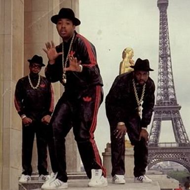 This image represents 1980's men's fashion because of the leather sweatpants,the leather baggy jackets.Also the hats,the eyewear,and the gold chains.