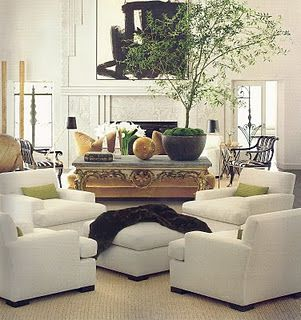 Four chairs for cozy conversations love this space planning. I also love that tree.