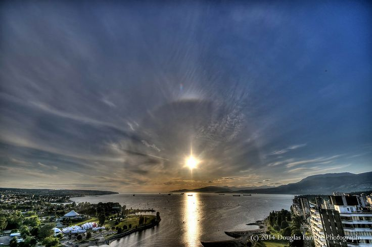 The 22' and very rare 46' solar halos add a touch of astronomical elegance to a Friday afternoon over Vancouver's English Bay.