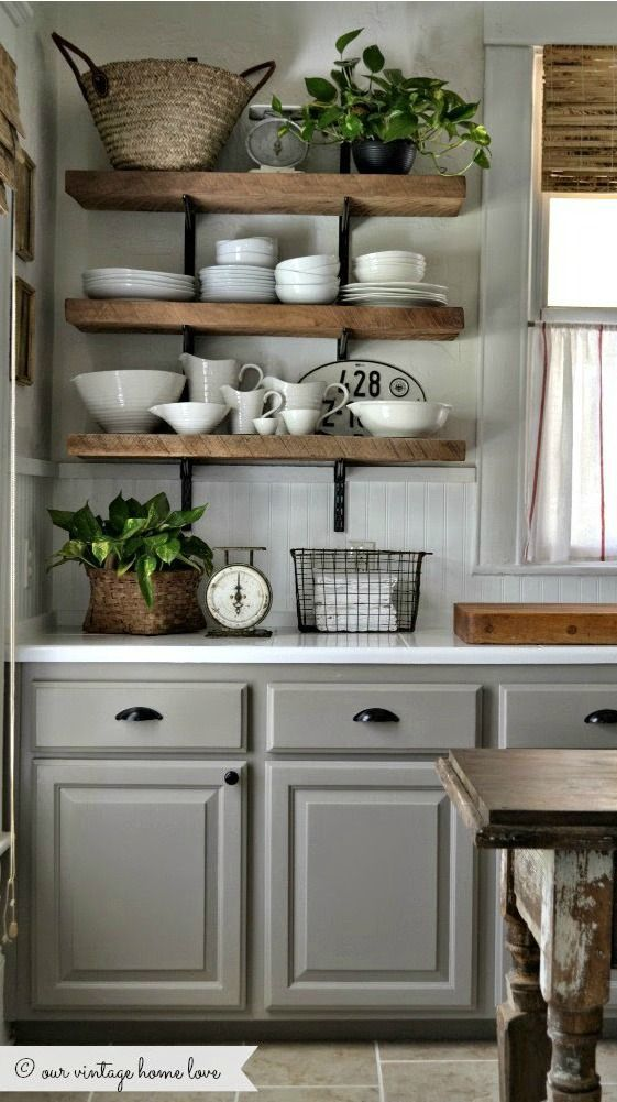 Get inspired to keep your kitchen organized and update its design in one fell swoop, with this collection of 23 Rustic Farmhouse Decor Ideas. We particularly love the look of the dark gray cabinets with exposed beam shelving that showcases your favorite dishwear!