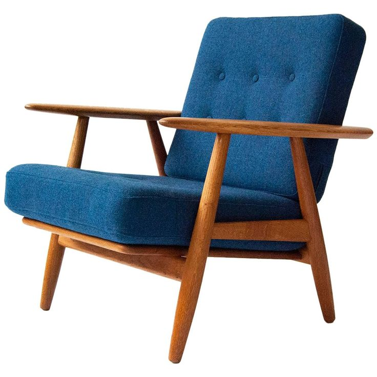 Hans J. Wegner GE-240 Oak 'Cigar' Chair, circa 1955 | From a unique collection of antique and modern lounge chairs at https://www.1stdibs.com/furniture/seating/lounge-chairs/