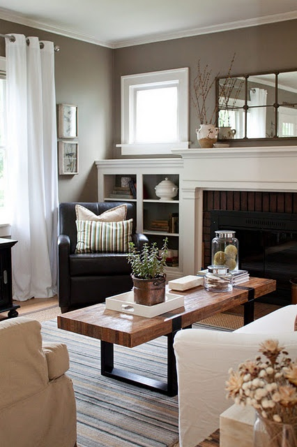 Grey walls, white trim - living room with built ins next to fireplace. Beautiful