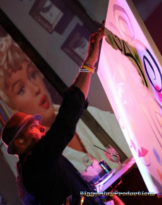 A picture from my photo shoot at the 2012 Vail Film Festival. Starting with the first brushstroke to the last of Tribeca Pop Artist Michael Perez painting to Marilyn Monroe screening in the background. :)Jhoney