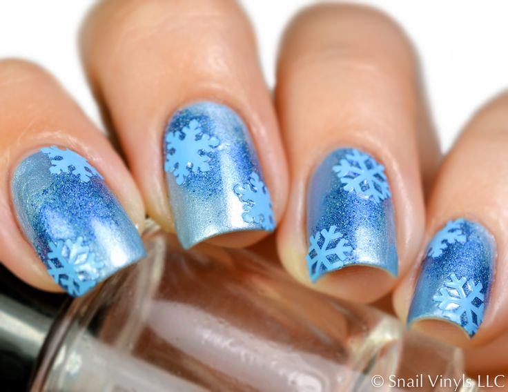 A Winter Snowflake Manicure is perfect for all of those holiday get togethers, Christmas socials and classroom parties. Easy nail art with Snail Vinyls nail vinyls, decals and stencils.
