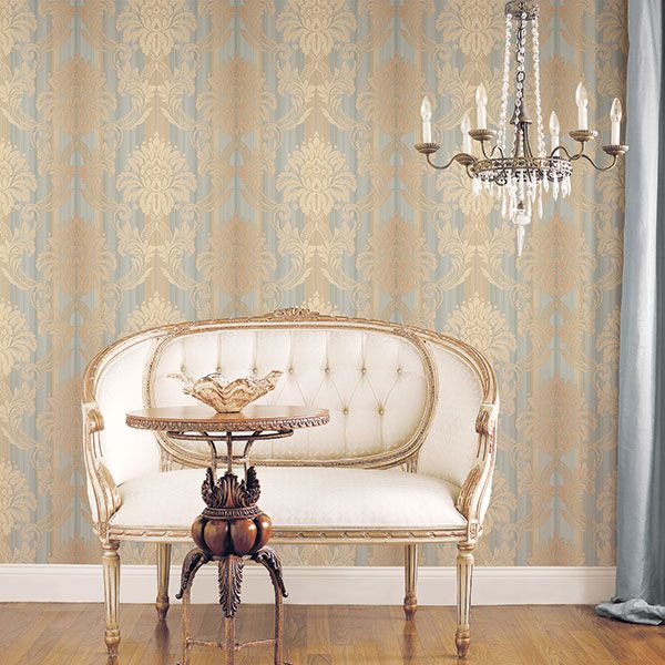 Everything about this room oozes classic glamour; the blue and gold damask wallpaper, the chandelier, the metallic touches, the chair and the exposed polished wood! Wallpaper from Classic Silks 3 by Galerie - CS35603R