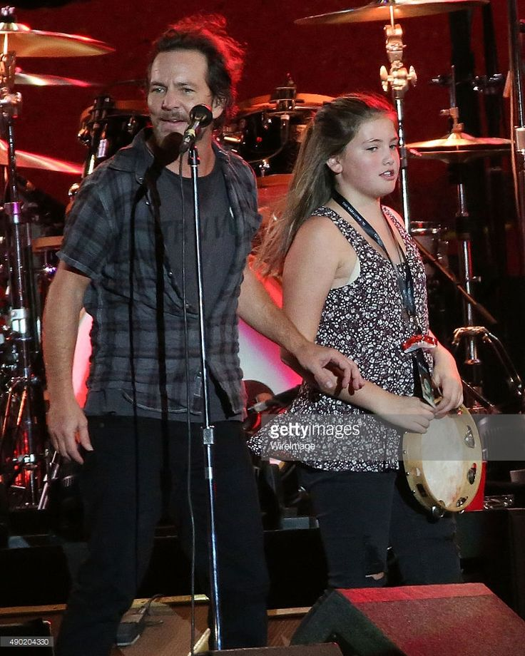 Eddie Vedder gives away his tambourine during the 2015 Global Citizen Festival at Central Park on September 26, 2015 in New York City.