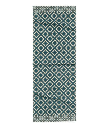 Rectangular cotton rug with a printed pattern at front.