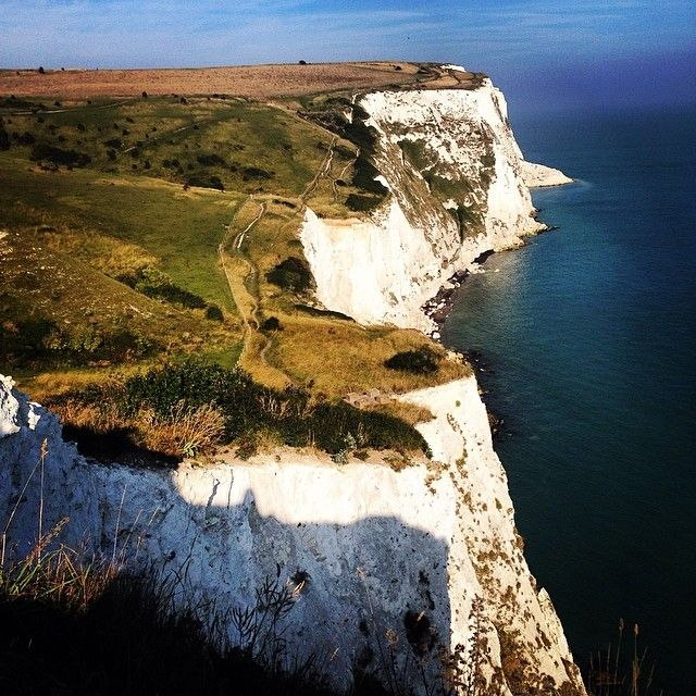 The white cliffs of #Dover. #England is another dream destination to check off your list! Photo courtesy of wanderlusterstravel on Instagram.