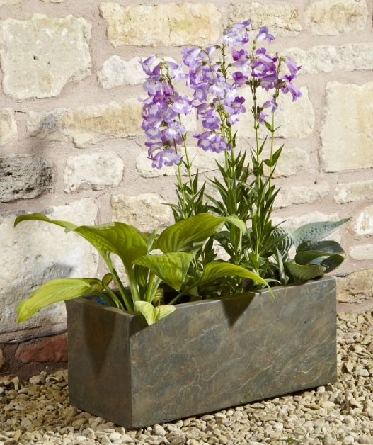 This stylish fibrecotta planter is perfect for those who want the look of real stone in their garden without the extra weight. With a realistic slate finish, this planter is great for making a statement in your garden while being extra durable and weather resistant. The cool natu