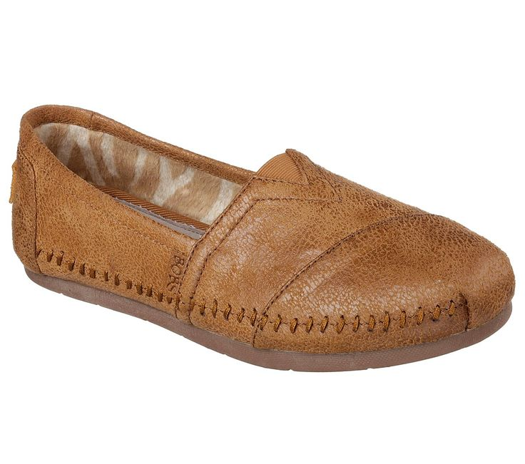 "Smooth style and comfort join together in the SKECHERS Luxe BOBS - Rain Dance shoe. Soft smooth microfiber suede upper in a slip on casual alpargata moccasin flat with stitching accents. Memory Foam insole. <br><b>BOBS helps make a difference for animals and kids - learn more <a href=""https://www.skechers.com/en-us/bobs-for-dogs""> here.</a></b>"