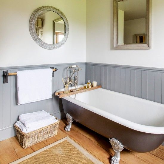 Country bathroom with grey roll-top bath and dado panelling