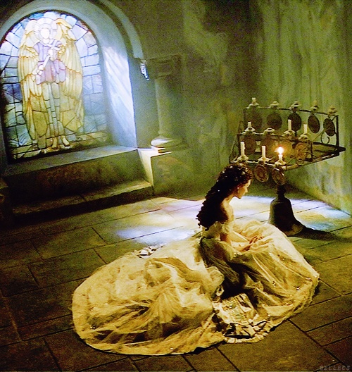 Emmy Rossum in Phantom of the Opera (2004) | my husband ( Ramin Karimloo ) is in this picture! He played Christine's father. He's in that little picture frame. :-)