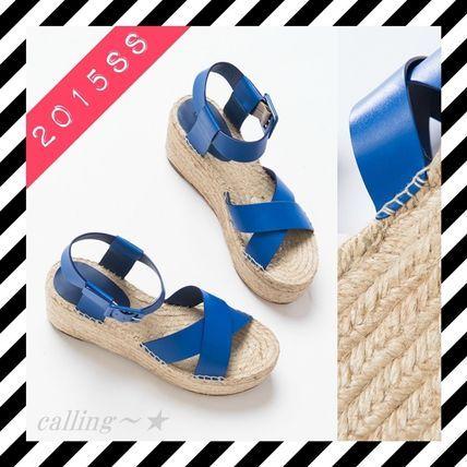2015SS新作!!関税.送料込!!★CELINE★Criss Cross Sandal 春夏スタイルにぴったりの爽やかなサンダルです。 高めのヒールですがウェッジソールで歩きやすい!エスパドリーユの素材感と青色が海を連想させますね☆