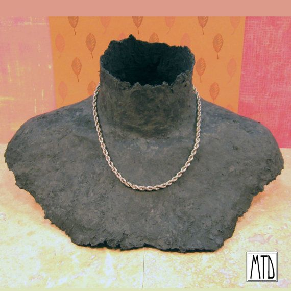 papier mache necklace display, could be done in paper/clay or painted. I could add a partial face with some convenient earlobes.