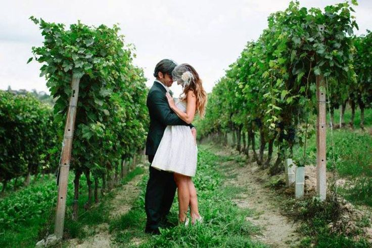 Shary and Adams, in a Vintachic 1980s wedding dress, in a northern Italian vineyard.