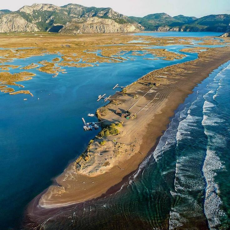 Across from you is a 4.5 kilometer long golden sand beach that stretch out into a river without a single house, a single store... Just nature and overlooking pine trees. This is İztuzu Beach in Dalyan!