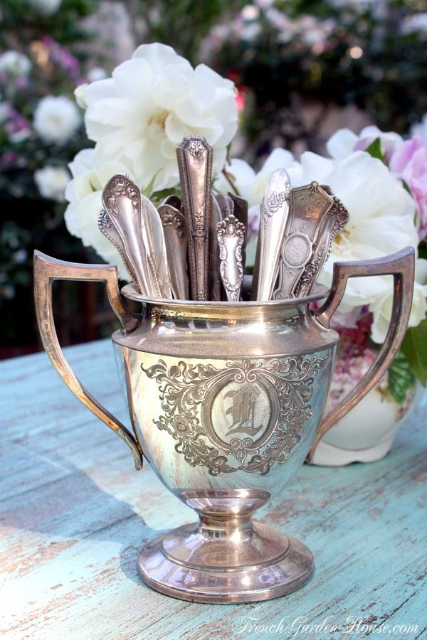 mismatched antique teaspoons in an antique silver sugar bowl