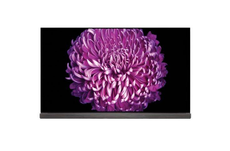 """LG OLED65G7V  Description: LG OLED65G7V: 65"""" ongekend detail Met de LG OLED65G7V hoef jij je geen moment te vervelen. Deze prachtige TV bied jou een wereld aan entertainment met fantastische beelden en mooi geluid. Deze Smart TV komt met de handige Magic Remote afstandsbediening waar jij in een mum van tijd door het entertainment bladert. Het prachtige design integreert naadloos in elk interieur in elke woonkamer en dankzij Active HDR geniet je keer op keer weer van loeischerpe beelden en…"""