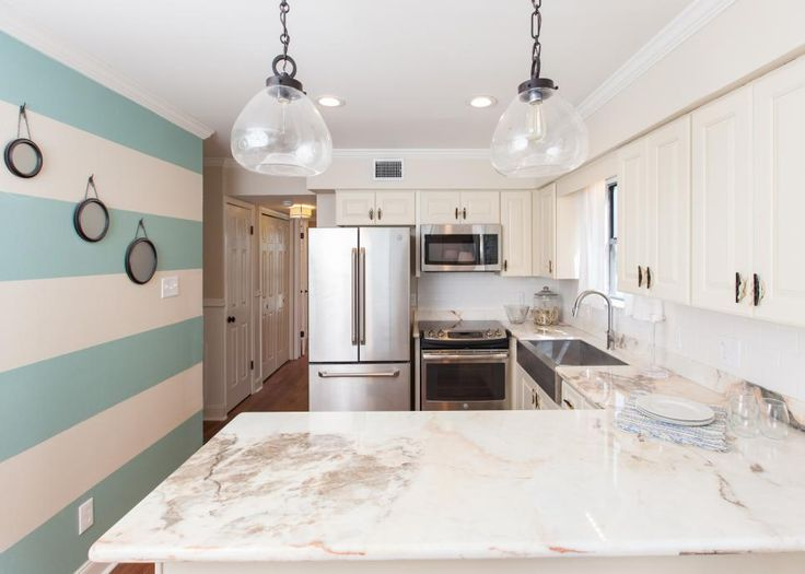 Sarah and Nick transformed this closed-off kitchen into a warm, open space full of nautical design details. See the design details and exclusive before-and-after photos.