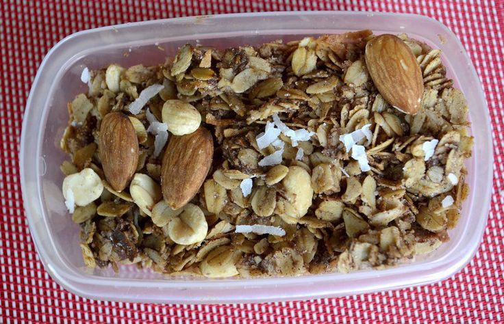 This homemade granola has almonds, peanuts, coconut, chocolate chips and a hint of cinnamon. It's a good source of fiber, protein, fat and carbs.
