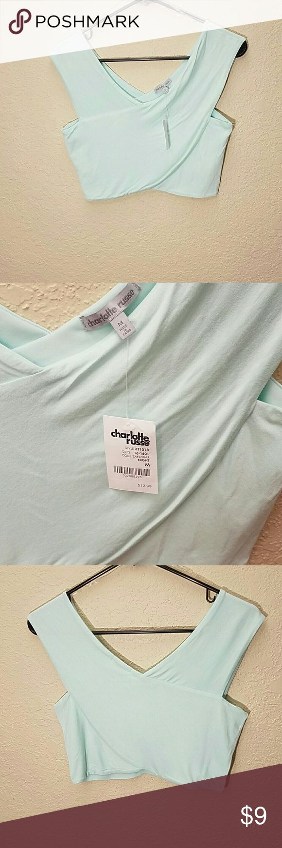 NWT medium crop top light blue  Charlotte Russe This is a medium sized crop top. Light Blue. From Charlotte Russe. New with tags, never been worn. Charlotte Russe Tops Crop Tops