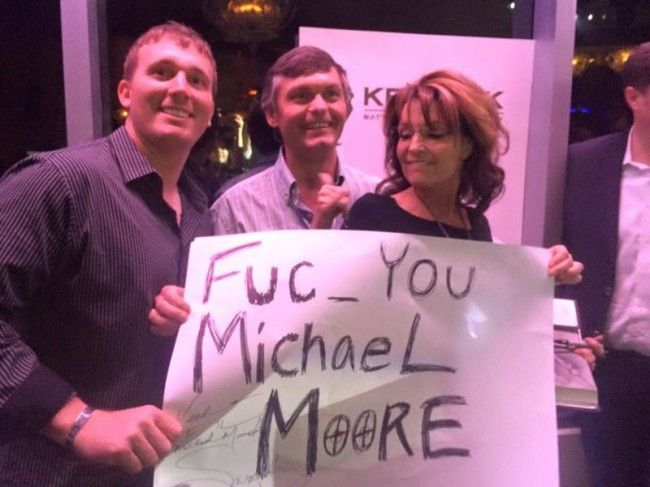 Sarah Palin .. With gun targets as O's .. No surprise, just another notch in her belt of ignorance.  Expose the truth, and she puts a target on you??!!  Michael Moore investigates situations that need attention, so Sarah Palin believes he deserves to be shot?  Je Suis Charlie