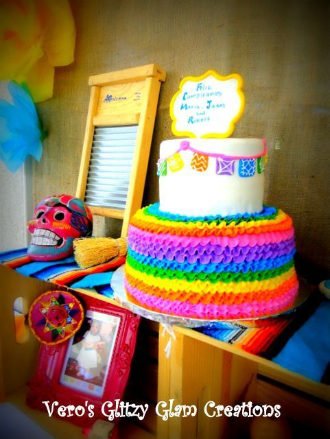 Papel picado rainbow cake at a Mexican Fiesta Birthday Party!  See more party ideas at CatchMyParty.com!