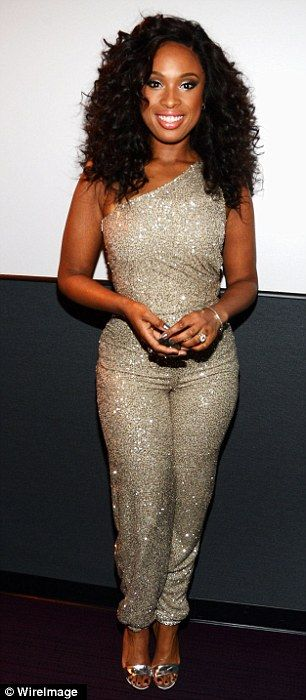 Jennifer's one-shoulder jumpsuit is closely fitted but then she brings volume at the top with her cool curls
