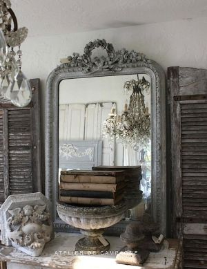 French mirrors paired with antique books, a great combination.