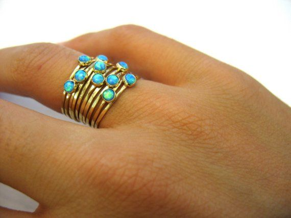 Stacked gold hammered rings with opal