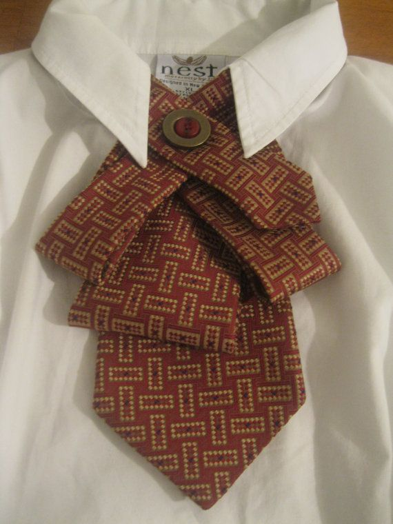 @: Upcycled tie necklace featuring a fun abstract tie in gorgeous shades of burgundy and gold..