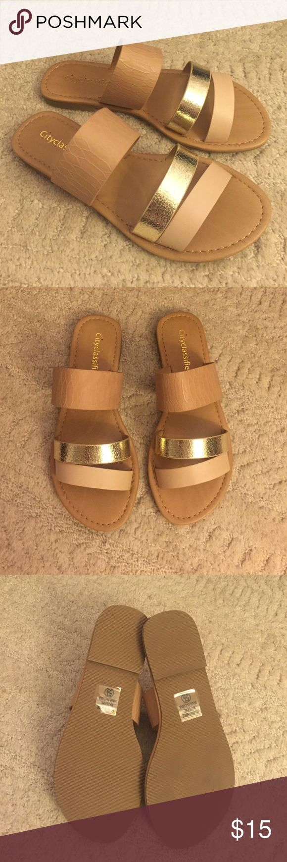 Tan Gold Strappy Flat Sandal Never worn. Very comfortable gold and tan strappy sandals Shoes Sandals