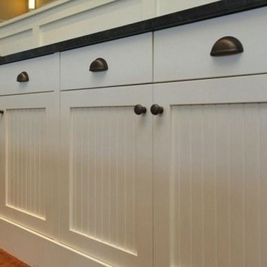 Farmhouse - Kitchen Hardware Ideas - Bob Vila; Beadboard and oil rubbed bronze hardware. Rosaaen-like the hardware and the cupboards. I would like cream, not white for cupboards.